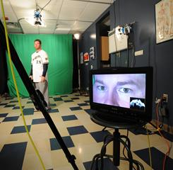 Pitcher Shaun Marcum, who joined the team via trade in the offseason, poses for the video that will be used on the Brewers' scoreboard.