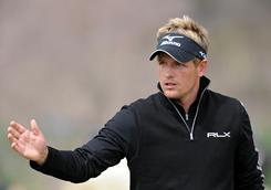Luke Donald of England acknowledges the cheers Sunday during his victory against Martin Kaymer in the final of the WGC-Accenture Match Play Championship in Marana, Ariz.