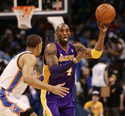 Guard Kobe Bryant, passing the ball around Thunder guard Thabo Sefolosha during the first half, scored 17 points to help Lakers hold on for a 90-87 win.