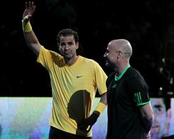 Pete Sampras, left, and Andre Agassi soak in the cheers on the court at Madison Square Garden at the BNP Paribas Showdown on Monday night.