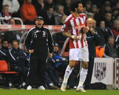 Stoke City manager Tony Pulis yells out during Stoke's tie with West Brom. Carlos Vela equalized at the gun for West Brom; Pulis felt Vela was offside.