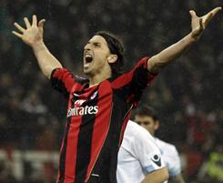 Forward Zlatan Ibrahimovic celebrates his opening goal in AC Milan's shutout of Napoli on Monday.