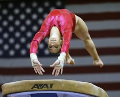 Alexandra Raisman, warming up on the vault Aug. 14, says she'd love to be a part of a gold medal-winning U.S. team.