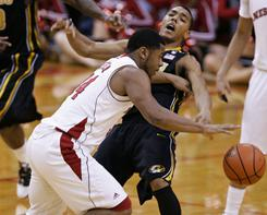 Nebraska's Lance Jeter, front, fouls Missouri's Phil Pressey in the first half of their Big 12 matchup on Tuesday. The Cornhuskers upset the No. 24 Tigers 69-58.