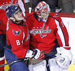 Alex Ovechkin (8) celebrates his overtime goal with goalie Michal Neuvirth that lifted the Capitals to a 2-1 win against the Islanders.