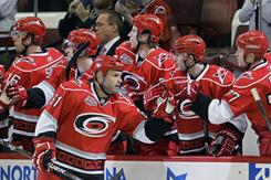 Cory Stillman gets congratulated by his new Hurricanes teammates after his goal against his former team, the Panthers, in the opening period Tuesday night. Stillman and Carolina defeated Florida 2-1.