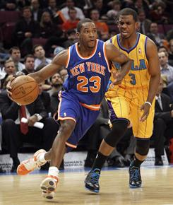 Knicks guard Toney Douglas, left, drives past the Hornets' Chris Paul during the first half Wednesday night at Madison Square Garden. Douglas had 24 points in New York's win.