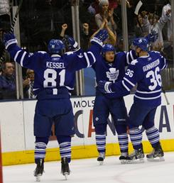 Toronto's Mikhail Grabovski, center, celebrates his game-winning goal against Pittsburgh with his teammates on Wednesday night. The Maple Leafs beat the Penguins 3-2 in overtime.