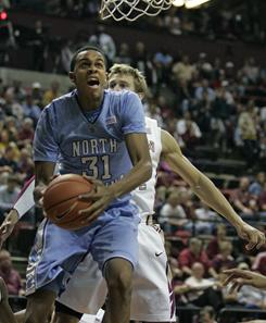 North Carolina's John Henson works against the defense of Florida State's Deividas Dulkys in the first half of their game on Wednesday night in Tallahassee, Fla.