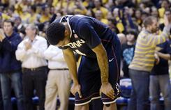Connecticut's Jamal Coombs-McDaniel reacts during a 65-56 loss to West Virginia, Wednesday night, during their game in Morgantown, W.Va.