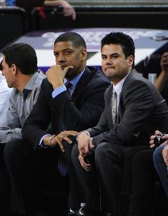 Sacramento Mayor and former NBA guard Kevin Johnson (center) watches from the sidelines during the second quarter of the Sacramento Kings' home loss Monday to the Los Angeles Clippers.
