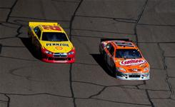 Kyle Busch (18) leads Kurt Busch (22) during Sunday's Subway Fresh Fit 500 at Phoenix International Raceway. The Busch brothers lead the Sprint Cup standings after two races.