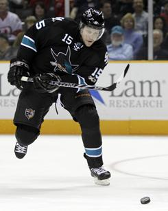 Dany Heatley scored two of the Sharks' three goals as San Jose downed the Red Wings to maintain their playoff position.
