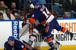 New York Islanders forward Trevor Gillies gets a game misconduct for his hit on Cal Clutterbuck.