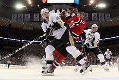 Penguins teammates Zbynek Michalek, left, and Paul Martin defend against the Devils' Ilya Kovalchuk during their game Friday in Newark. Kovalchuk's score in overtime lifted New Jersey to a 2-1 win over Pittsburgh.