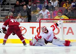 Radim Vrbata, left, scores the decisive shootout goal past the Red Wings' Jimmy Howard in the Coyotes' 5-4 win.