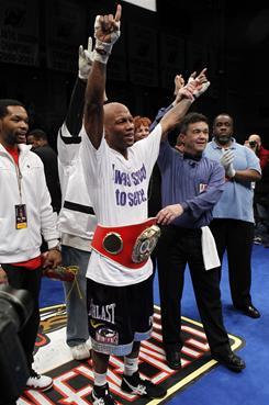 Zab Judah celebrates regaining the IBF junior welterweight title.