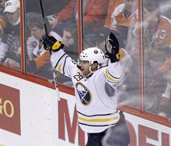 Buffalo's Jason Pominville celebrates after scoring a goal in the third period against the Philadelphia on Saturday. The Sabres beat the Flyers 5-3.