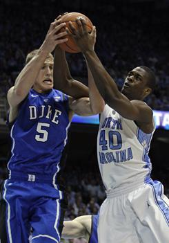 Duke's Mason Plumlee (5) and North Carolina's Harrison Barnes (40) reach for a rebound during the first half in Chapel Hill, N.C. Barnes' Tar Heels 81-67.