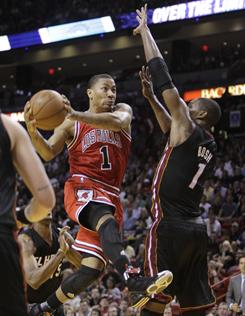 The Bulls' Derrick Rose (1) drives past the Heat's Chris Bosh on his way to the basket during the fourth quarter of Chicago's 87-86 win in Miami.
