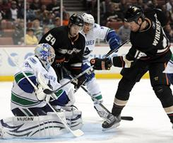 Vancouver Canucks goalie Cory Schneider stops Brad Winchester's shot during a 3-0 win over the Ducks in Anaheim, Calif.