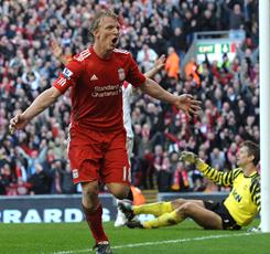 Liverpool's Dutch forward Dirk Kuyt celebrates scoring his third goal during the English Premier League game between Liverpool and Manchester United at Anfield, Liverpool, England, on March 6.