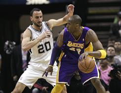 Lakers guard Kobe Bryant, right, backs down Spurs guard Manu Ginobili during the first half. Los Angeles routed San Antonio 99-83.