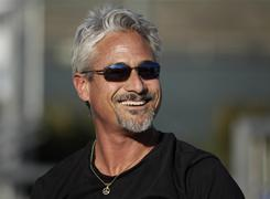 Olympic gold medalist Greg Louganis coaches young divers from SoCal Divers at Fullerton College in Fullerton, Calif.