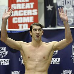 Michael Phelps waves to the crowd following his win in the 200-meter freestyle at the USA Swimming Grand Prix swim meet in Indianapolis, on March 3.