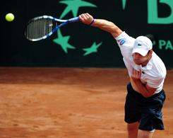 Andy Roddick serves up a victory Sunday against Paul Capdeville to clinch the first-round Davis Cup match for the USA against Chile in Santiago.