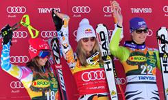 Lindsey Vonn (center) celebrates on the podium with second-place finisher Julia Mancuso (left) and German Maria Riesch (right) at the FIS World Cup women's super G in Tarvisio, Italy, on March 6.