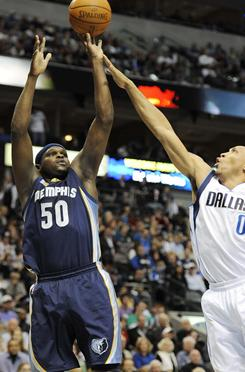 Grizzlies forward Zach Randolph, left, shoots over the Mavericks' Shawn Marion during first-half action Sunday. Randolph scored 27 points, including the game-winner to help Memphis beat Dallas 104-103.