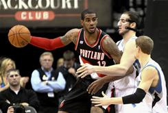 As the focal point of a Trail Blazers offense missing Brandon Roy, LaMarcus Aldridge, left, backing down Timberwolves defenders during a Jan. 7 game, is getting more touches. He's also versatile enough to defend all five positions.