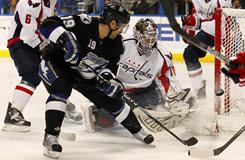 Capitals goalie Braden Holtby, right, makes one his 21 saves by denying the Lightning's Dominic Moore during the second period of their game Monday night. Washington beat Tampa Bay 2-1.