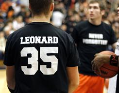 Fennville High boys basketball players wore the number of their teammate Wes Leonard during pregame warm-ups at the Michigan state tournament Monday. Leonard collapsed and died last week.