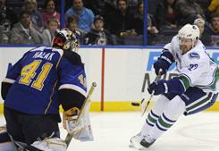 St. Louis Blues goalie Jaroslav Halak, stopping Daniel Sedin, beat the Vancouver Canucks 3-2 in his last start on Feb. 14.