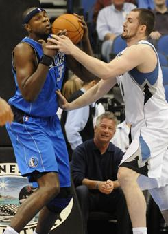 Kevin Love, right, tied Moses Malone's double-double record (51), but the Timberwolves still fell to the Mavericks in Minnesota.