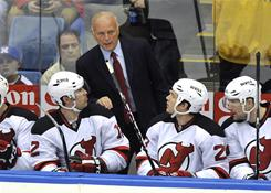 New Jersey Devils head coach Jacques Lemaire gives instructions to Brian Rolston, left, David Clarkson, center, and David Steckel during Sunday's game against the New York Islanders.