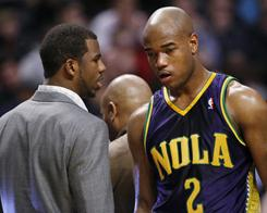 Hornets guard Chris Paul, left, talks with guard Jarrett Jack during a break in the first half of Monday's game against the Bulls. Jack, who got the start with Paul sidelined with a concussion, scored 23 points in the losing effort.