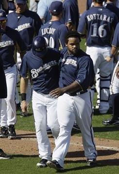 Milwaukee Brewers' Prince Fielder, right, and Mark Kotsay, left, walk to the dugout after the sixth inning of a spring training baseball game against the Los Angeles Dodgers on Tuesday, in Phoenix.