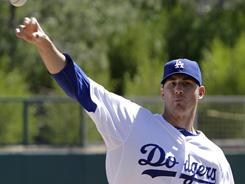 The Dodgers' Jon Garland is the second pitcher in the starting rotation to suffer an injury this spring.