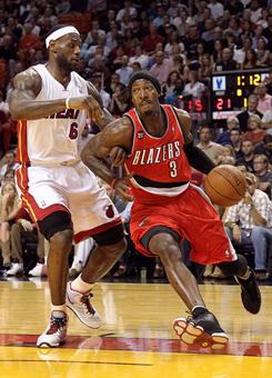Gerald Wallace, right, drives past the Heat's LeBron James during Tuesday's game in Miami. Wallace had 22 points in Portland's win.