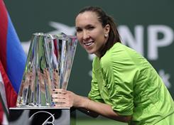 Jelena Jankovic of Serbia, posing with her trophy last year, is the defending champion at the  BNP Paribas Open in Indian Wells, Calif.