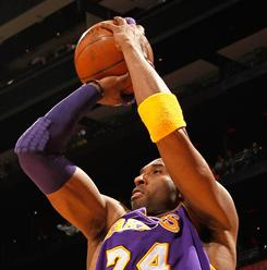 Lakers guard Kobe Bryant scored 26 points in Tuesday's win over the Hawks to move into sixth place on the NBA's career scoring list.