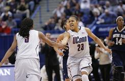 Connecticut's Maya Moore (23) and Tiffany Hayes (3) celebrate after a play against Notre Dame during the Big East women's tournament championship game. Connecticut won 73-64.