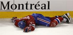 Canadiens wing Max Pacioretty lays on the ice after taking a hit by the Bruins' Zdeno Chara during the second period.