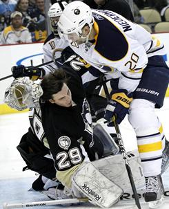 The Sabres' Rob Niedermayer knocks the helmet off Penguins goalie Marc-Andre Fleury after he scored in the first period. Fleury had 29 saves on the night in the Penguins 3-1 win.