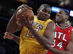 Lakers center Andrew Bynum, left, pulling down a rebound in front of Hawks center Jason Collins during a Feb. 22 game, is averaging almost 17 rebounds and four blocks in his last three games.