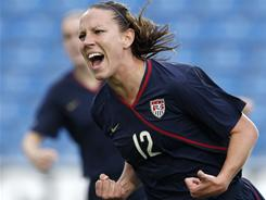 The USA's Lauren Cheney celebrates after scoring to tie the Algarve Cup final against Iceland.