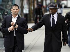 NFLPA executive committee member Sean Morey, left, and NFLPA executive director DeMaurice Smith arrive for labor negotiations on Wednesday.